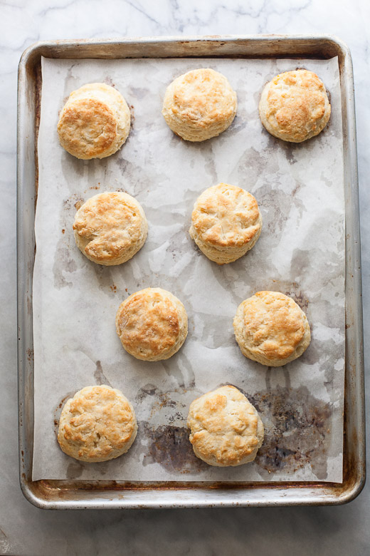 How to Make Flaky Biscuits | Baked flaky biscuits on a lined baking sheet
