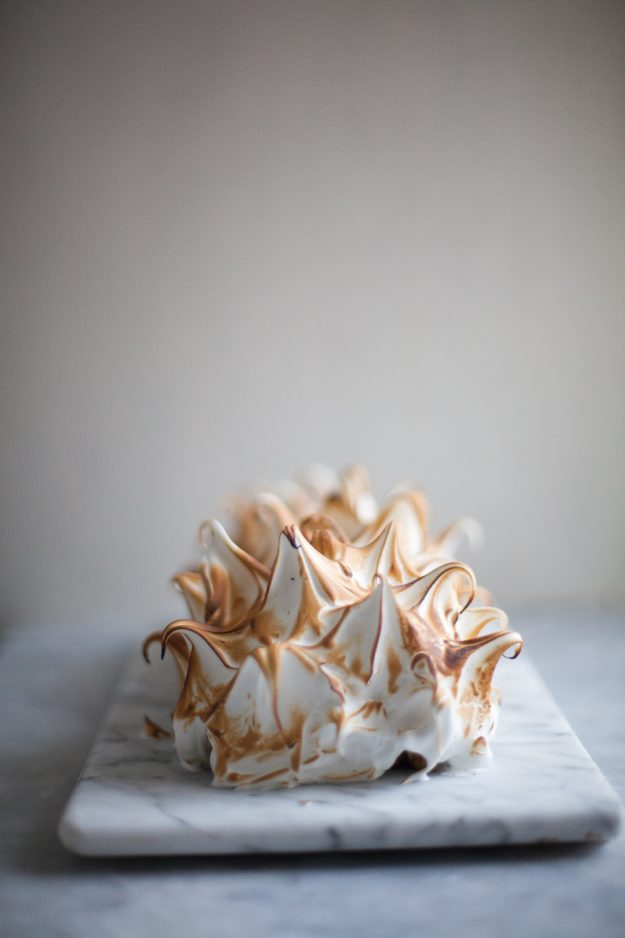 Banana bread roll cake filled with cream cheese frosting and covered in Swiss meringue | Photo by Zoë François