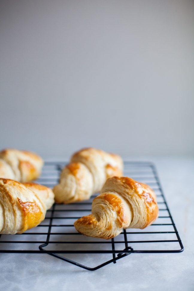 Croissants cooling on a wire rack   Photo by Zoë François