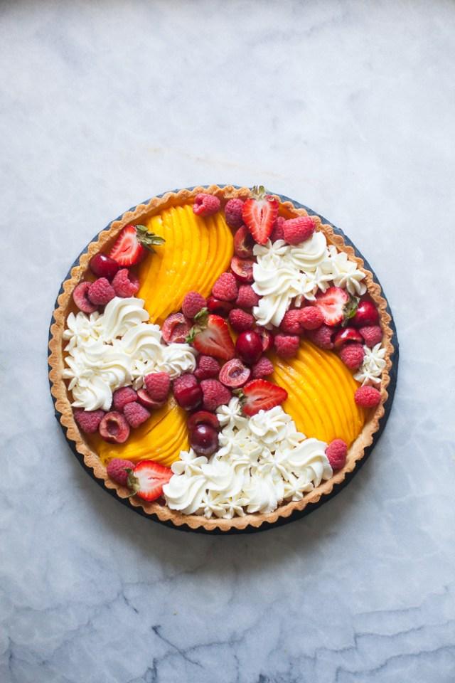 Mango Curd Tart with fresh mango, berries and whipped cream