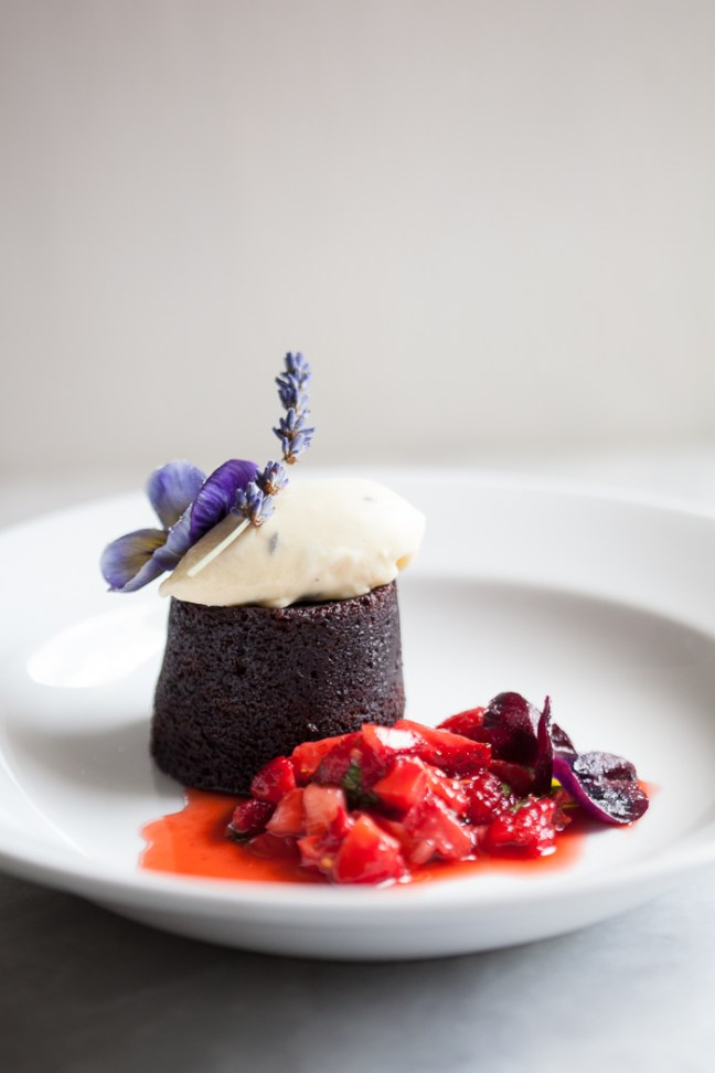 Chocolate Fudge Cake with Strawberry Salsa and Candied Flowers   ZoeBakes photo by Zoë François