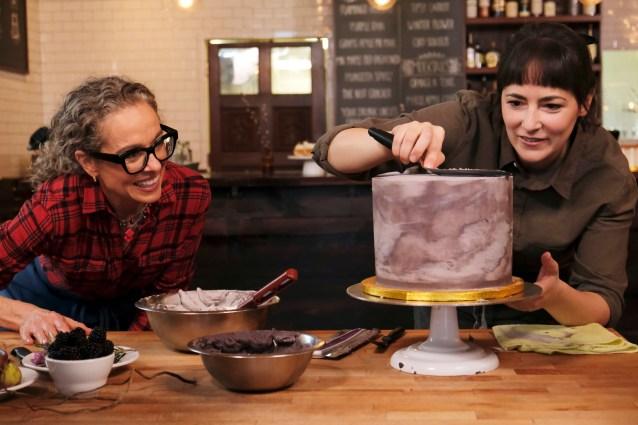 Pastry chef Minda Ringdahl shows host Zoe Francois decorating techniques, as seen on Zoe Bakes, season 1.