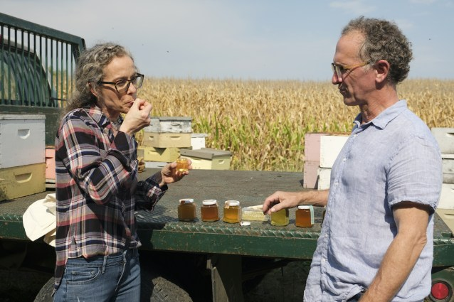 Host Zoe Francois tastes different honey varieties with Brian Fredrickson, owner of Ames Farm