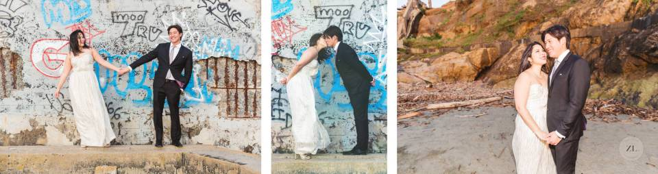 couple kissing at engagement session in front of street art wall