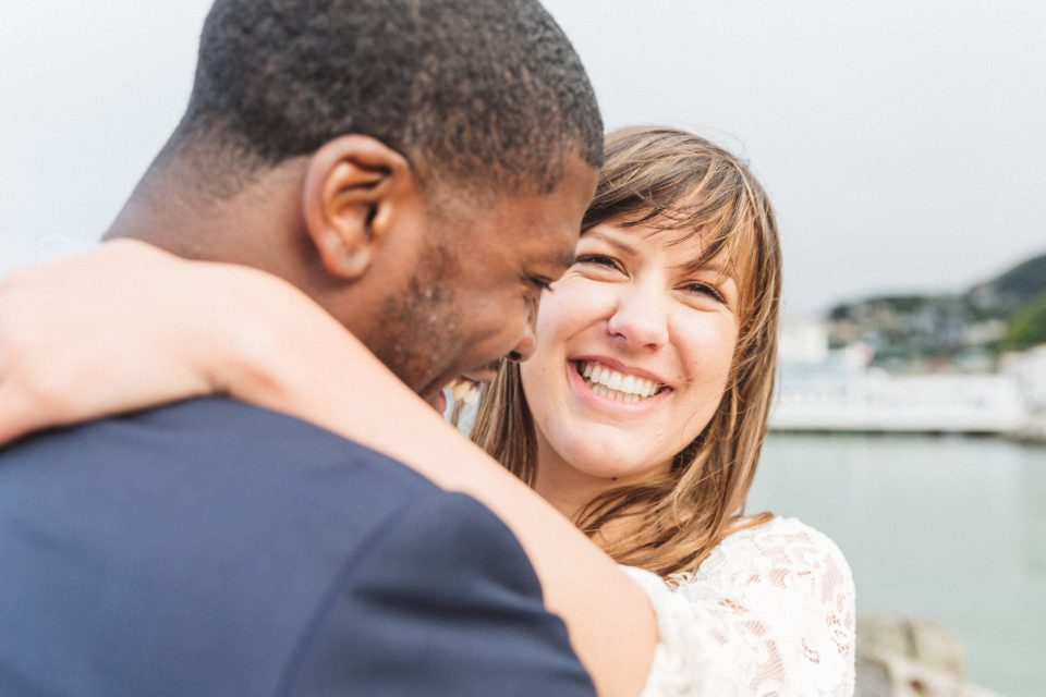 sausalito engagement photos by the water with woman laughing