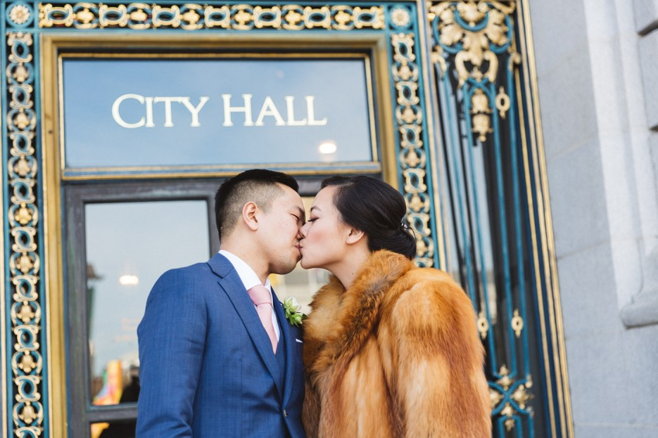just married couple kissing outside city hall photography