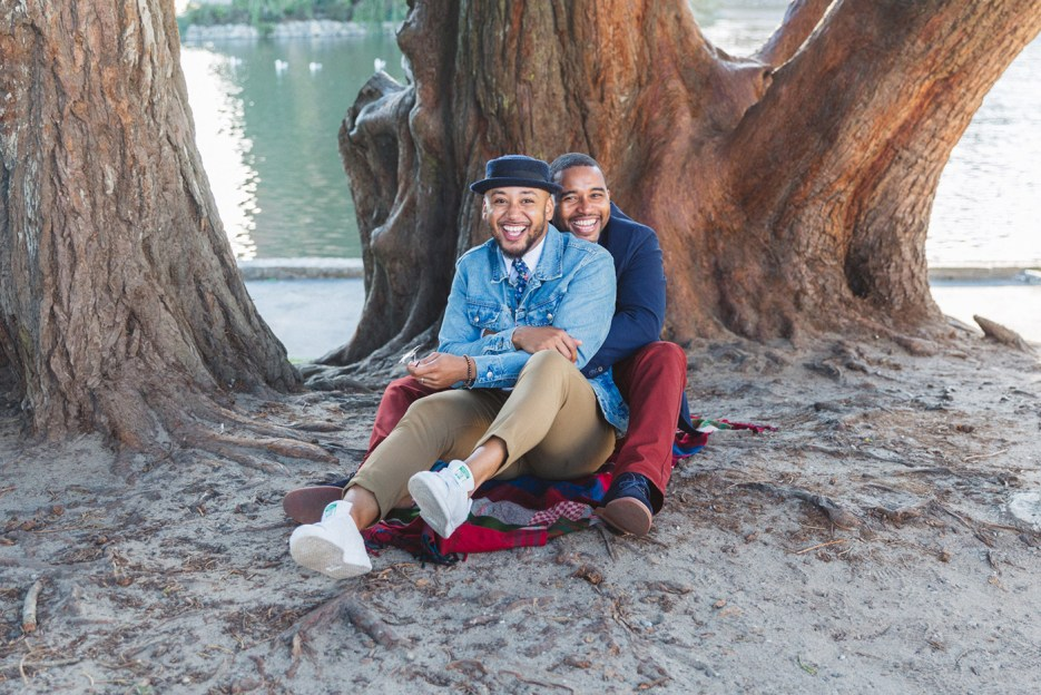two men happily in love at san francisco engagment session palace of fine arts