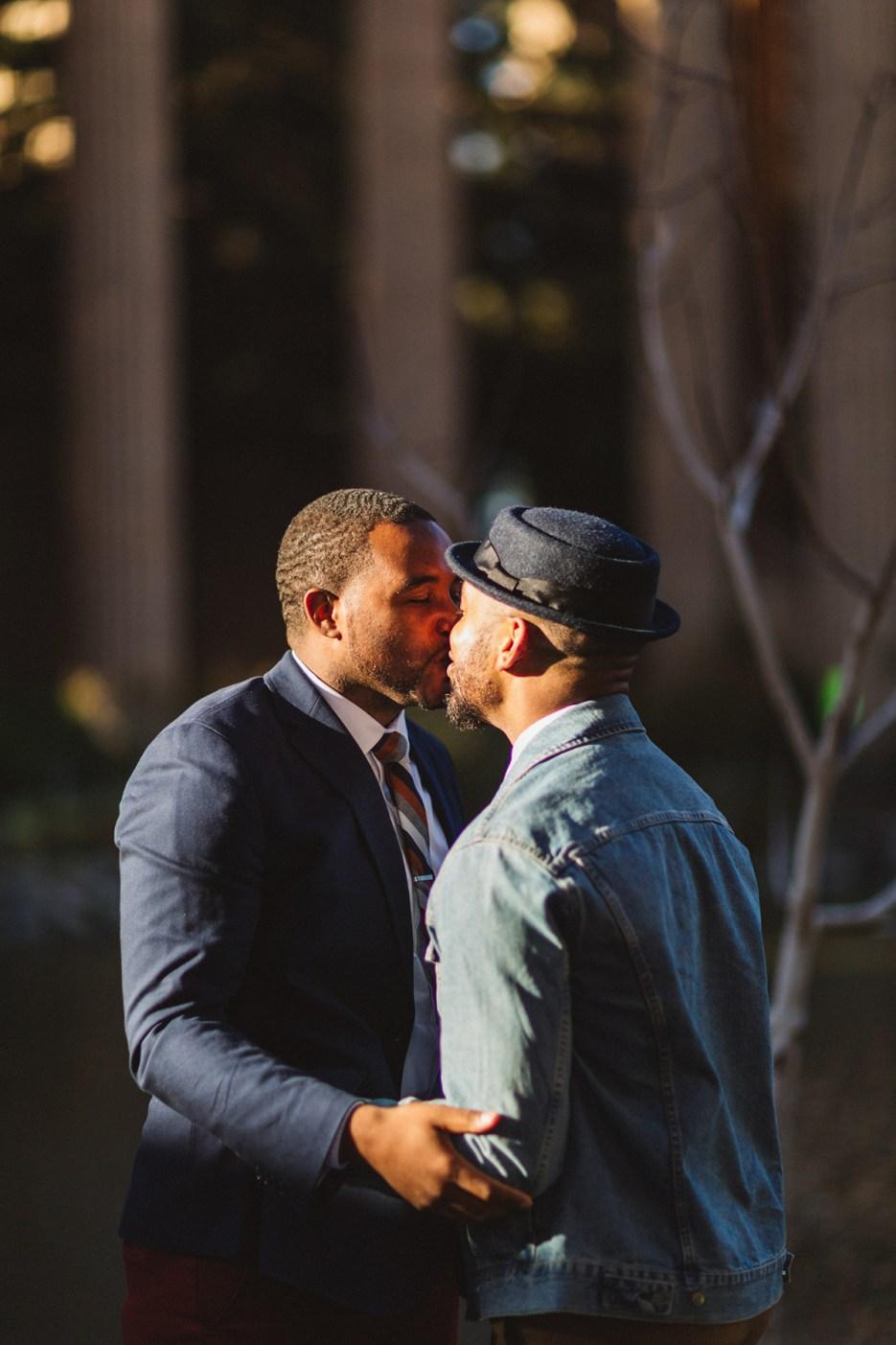 gorgeous men lit by golden sun kissing in san francisco