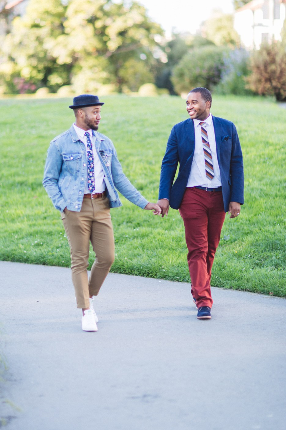 two gay men walking happily at sf engagement session