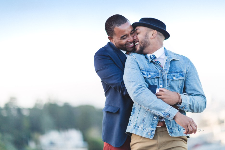 gay male engaged couple nuzzling and cuddling at corona heights