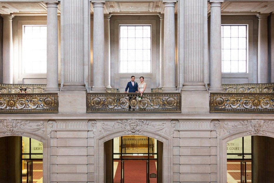 married couple from across the balcony sf city hall wedding photography