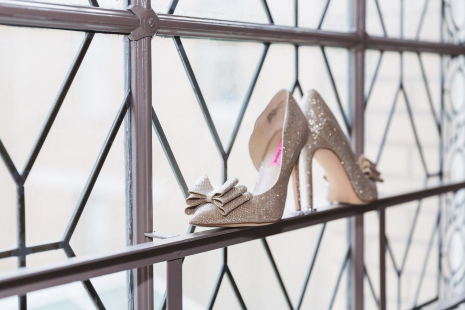 bridal shoes placed on window ledge for detail photography