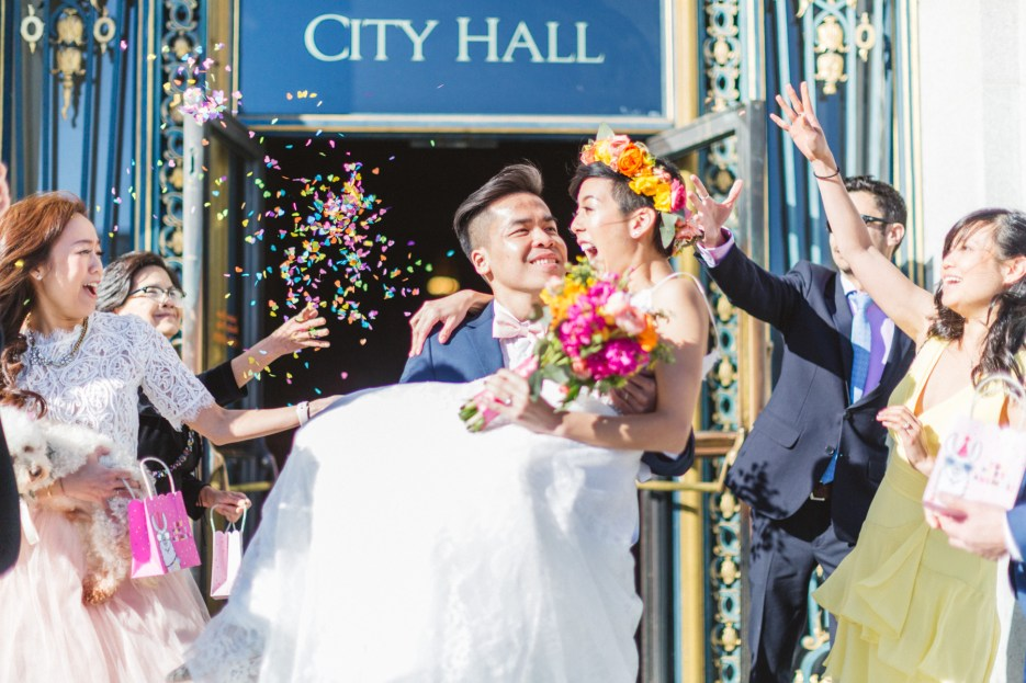 bride carried out of city hall with confetti