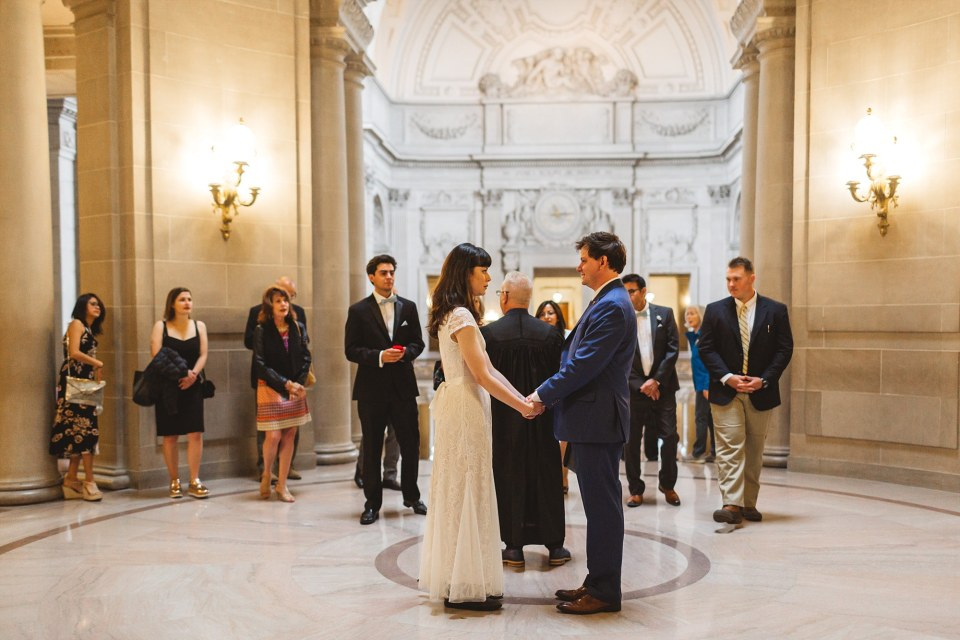 san francisco city hall wedding photography of wedding ceremony in rotunda