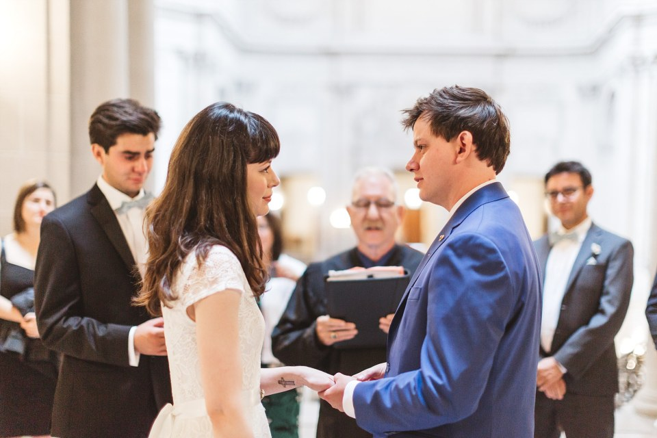 couple marrying at city hall looking into each other's eyes showing Candid city hall photos