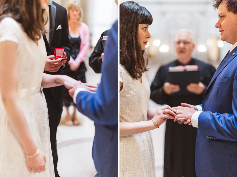ring being placed on finger at san francisco city hall wedding ceremony