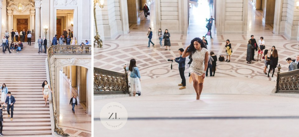 model walking up grand staircase at city hall with lots of people in the background