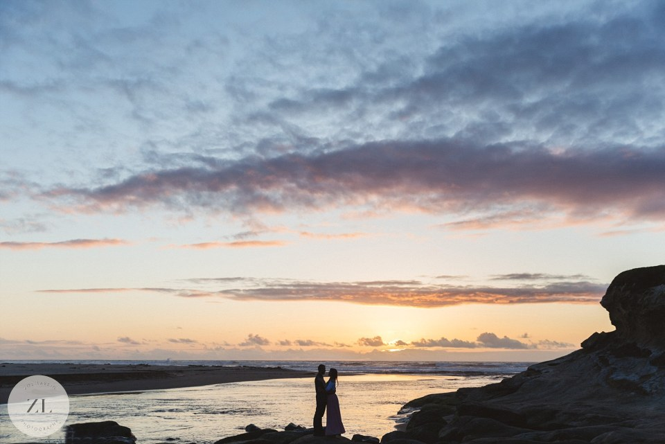 San Gregorio beach engagement - couple silhouetted against sunset sky
