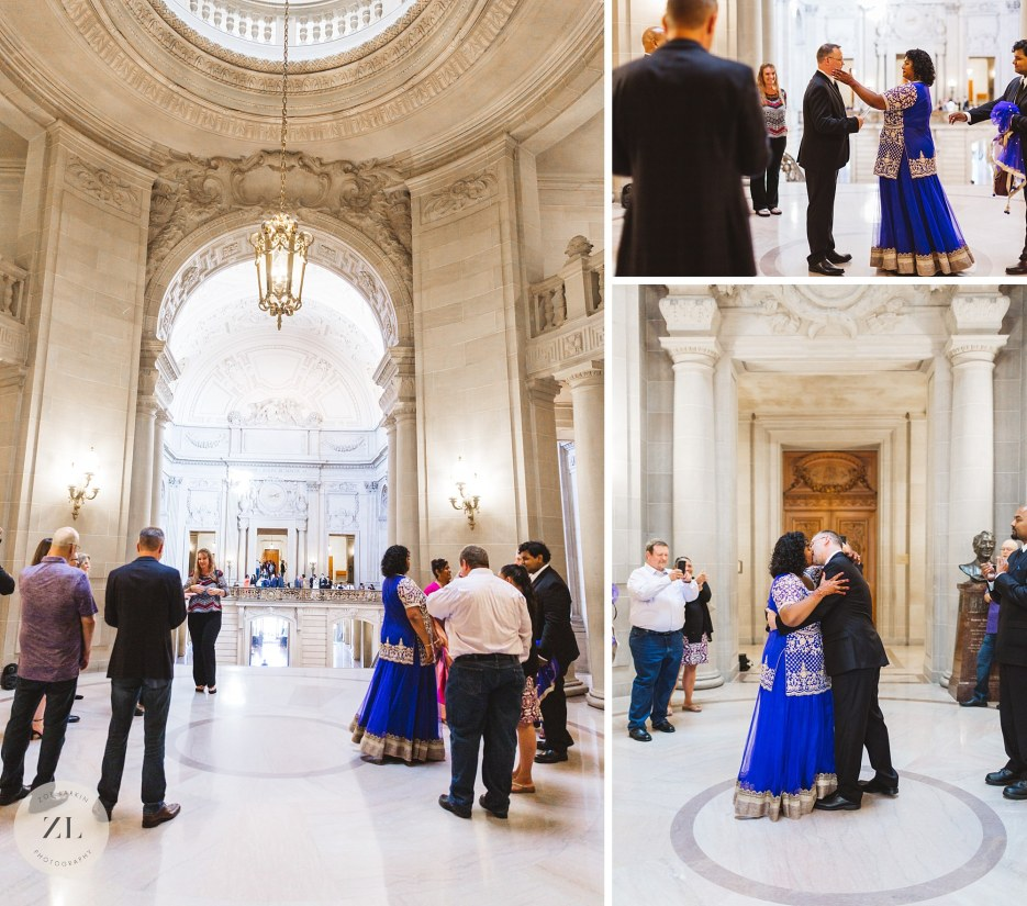 san francisco city hall wedding ceremony in rotunda first kiss