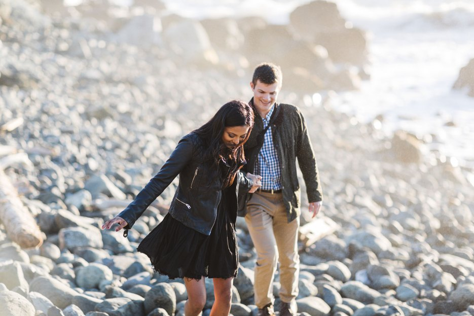 couple on rocky rugged san francisco beach during engagement session