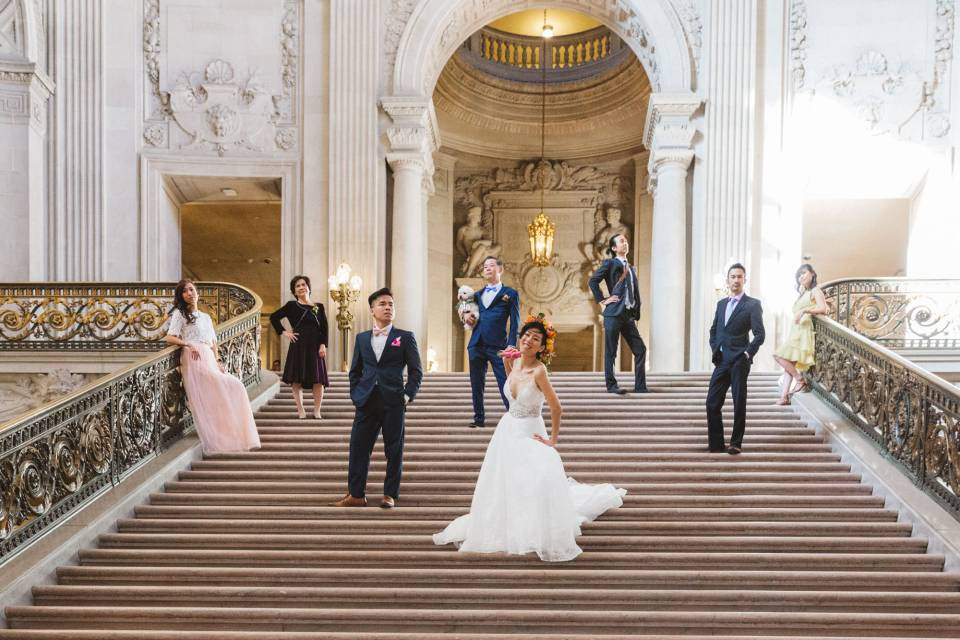 family posing on staircase of sf city hall vogue style