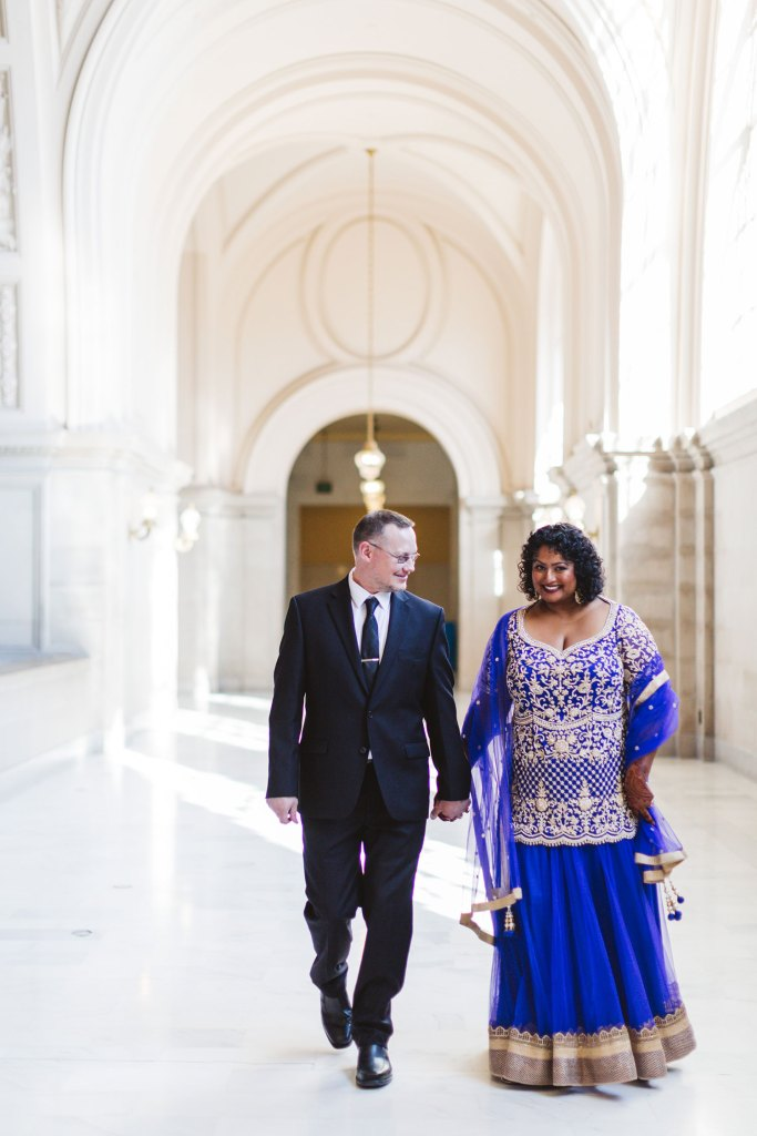 formal elegant city hall wedding couple walking in 4th floor gallery