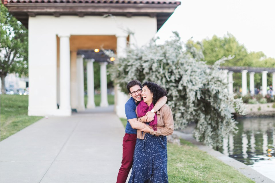 sweet lake merritt oakland LGBTQ engaged couple by pergola