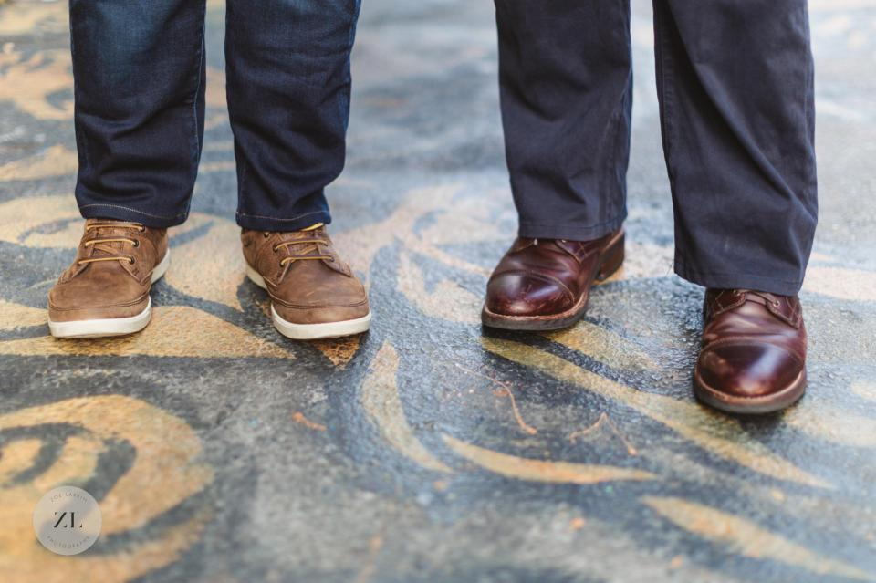 close up of male couples' shoes in clarion alley