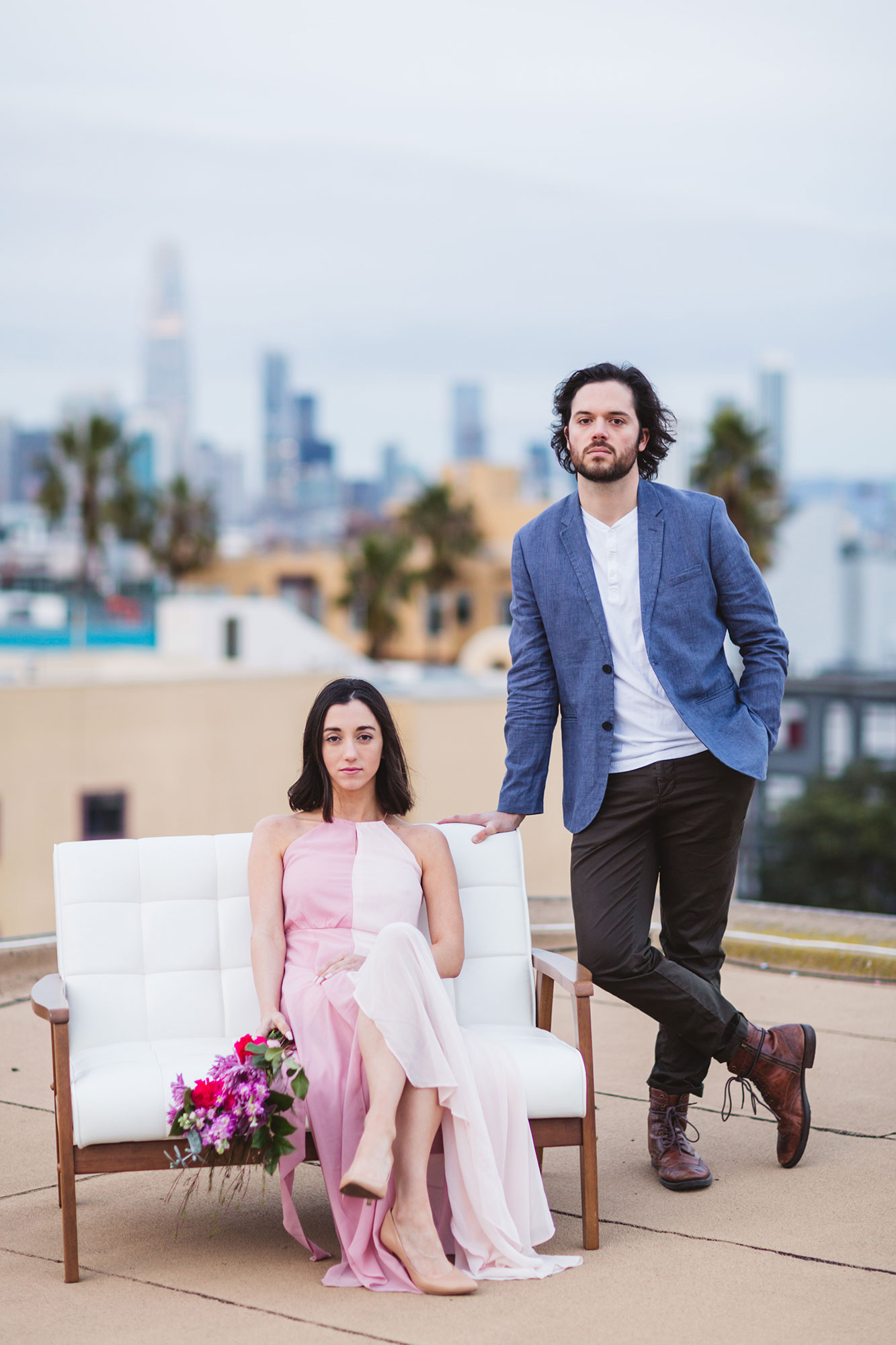 moody rooftop engagement shoot on couch