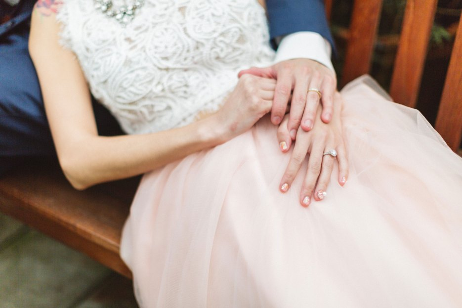hands on beautiful pink tulle wedding gown