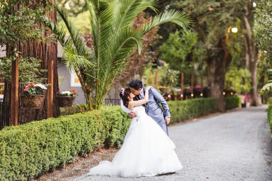 couple kissing on their wedding day at deer park villa