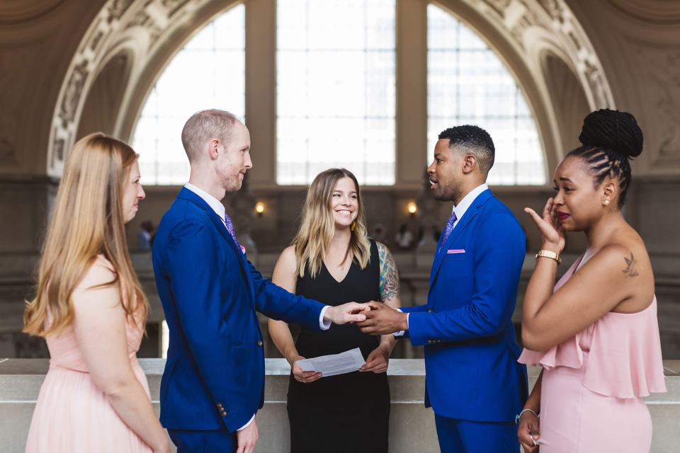 2 grooms wedding ceremony at LGBTQ+ City Hall wedding on 4th floor