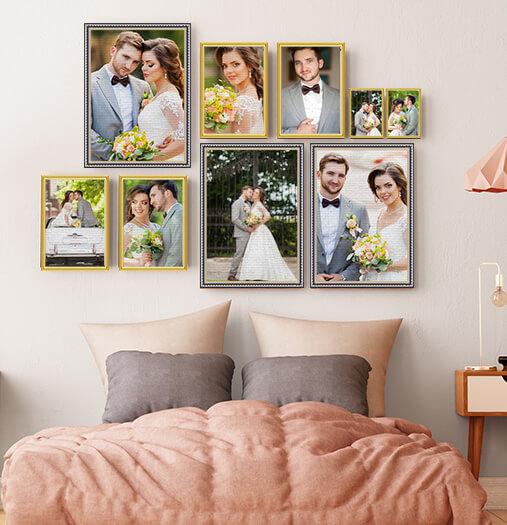 framed prints above bed of wedding images
