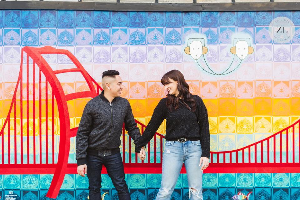 couple in front of colorful storefront in haight ashbury neighborhood haight ashbury engagement photography session SF