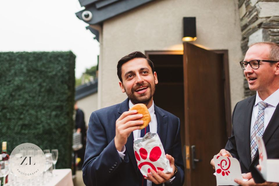 guest eating chick fil a at a bay area wedding - candid photo examples