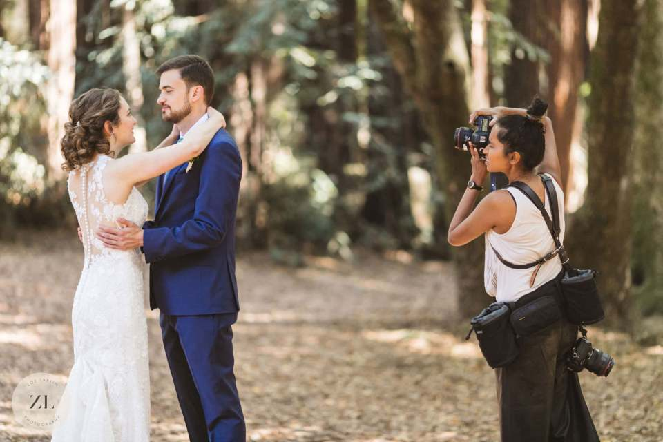 wedding photographer at work shooting a wedding
