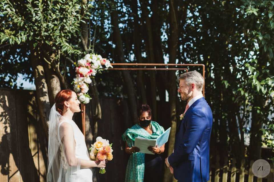 wedding couple getting married in their backyard in San Francisco captured by Zoe Larkin Photography