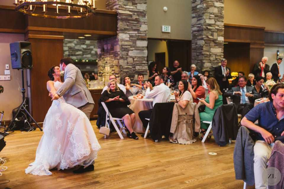 bride and groom first dance 'dip' photo at Oakland CA bay area wedding venue