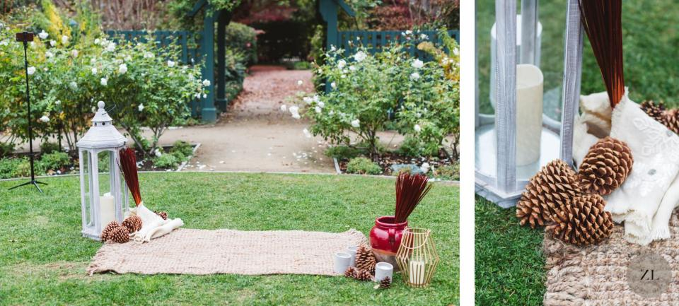ceremony space decorated with simple items including rugs, urns and wedding decor