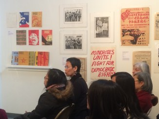 Fay Chiang in the audience with all of the posters and art from the movement started by Asian American Poets in the 1970s and 1980s