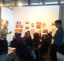 Legend Luis Franca read while young poet and curator Ryan Wong listens on the other side of the frame
