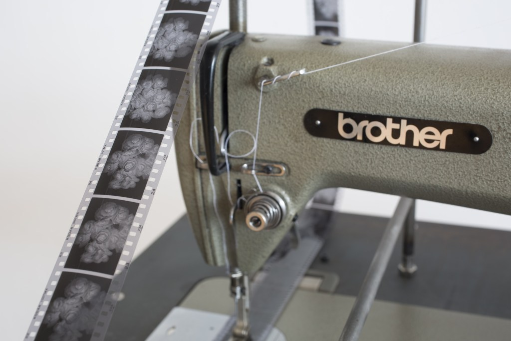 Frater by Leung Chi Wo, the Brother sewing machine punching through a film