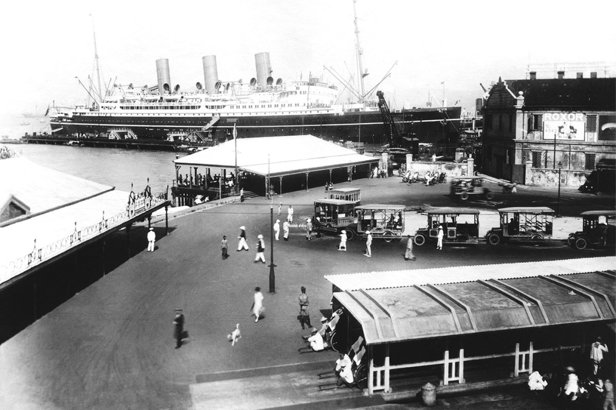 Star Ferry and bus terminal in Tsim Sha Tsui with Canadian Pacific Liner , circa 1925
