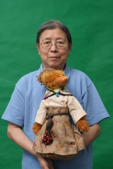 Author Xi Xi is holding Fan Li from The Bear Chronicles