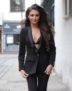 32656f4300000578-3501533-busty_putting_on_a_racy_display_in_a_plunging_black_blazer_and_f-a-29_1458496841933
