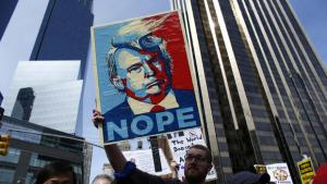 TOPSHOT - People rally as they take part in a protest against Republican presidential front-runner Donald Trump in New York on March 19,2016. / AFP / KENA BETANCUR        (Photo credit should read KENA BETANCUR/AFP/Getty Images)