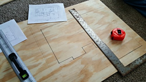 floor plan drawn on plywood for diy bird feeder