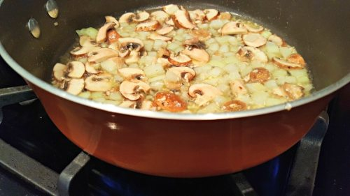 onions and mushrooms frying in a pan