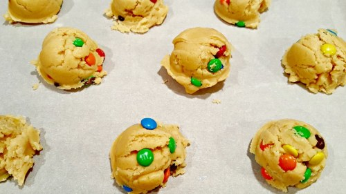 placing scooped cookie dough onto baking sheet