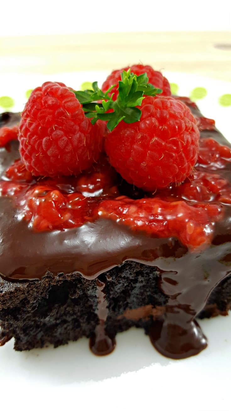 Brownies with Raspberry Sauce and Chocolate Ganache -These are amazing! The brownies are super chocolaty, light and fluffy with a cake-like texture and topped with a fresh raspberry sauce and smooth, creamy chocolate ganache. This recipe is downsized and makes 4 brownies, perfect for a small dinner party, family, or a romantic dessert for two 2 nights in a row!